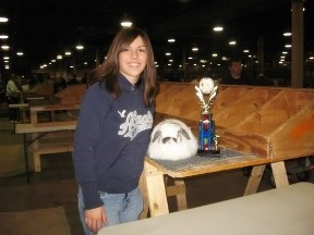 Happy Girl won Best of Breed with American fuzzy lop rabbit
